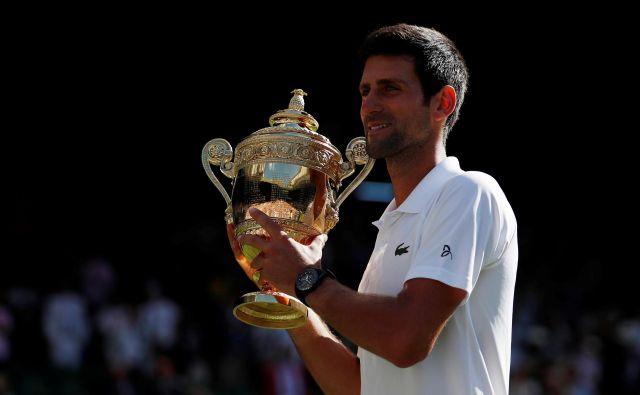 Novak Đoković je v dopoldnevu pred wimbledonsko zmago jedel le sadje in zelenjavo. FOTO: Andrew Boyers/Reuters