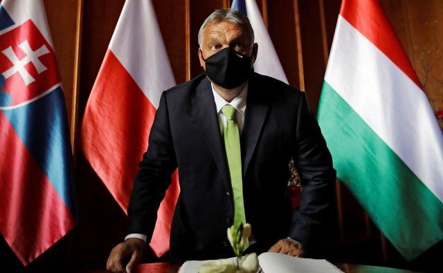 »Pričakujem opravičila od tistih, ki so prej doma in v tujini kričali o diktaturi,« je po torkovem glasovanju v parlamentu na svojem facebooku zapisal Orbán. FOTO: David W Cerny/Reuters
