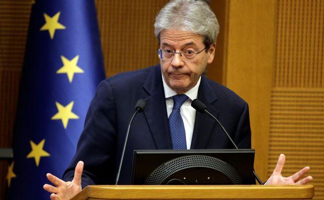 Komisar Paolo Gentiloni uradnega odgovora še ni dobil. FOTO: Max Rossi/Reuters