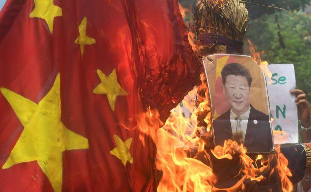 Xi Jinping si želi utrditi oblast in svojemu ljudstvu dokazati, da ne bo nihče več od zunaj – ne Amerika ne Indija – izzival svete zemlje pod kitajsko suvereniteto. FOTO: Dibyangshu Sarkar/AFP