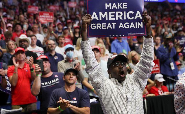 Temnopolti privrženec Donalda Trumpa v Tulsi.Foto Leah Millis Reuters