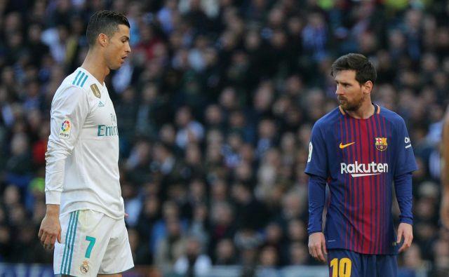 Cristiano Ronaldo (levo) se je predlani preselil v Italijo, Lionel Messi igra v prvi španski ligi od leta 2004. FOTO: Sergio Perez/Reuters