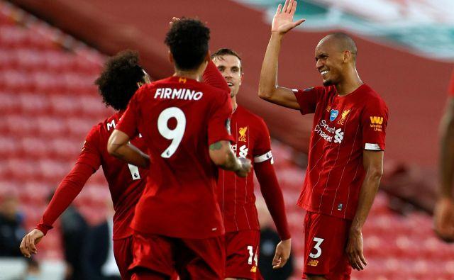 Nogometaši Liverpoola zmagujejo po tekočem traku in so tako po dolgih 30 letih tik pred naslovom prvaka. FOTO: Phil Noble/AFP