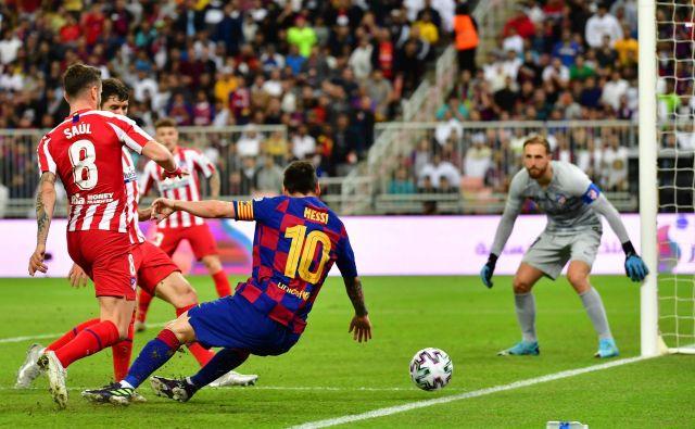 Jan Oblak in Saul Niguez sta bila med najboljšimi igralci Atletica, jutri se bosta vnovič soočila z Lionelom Messijem. FOTO: Giuseppe Cacace/AFP