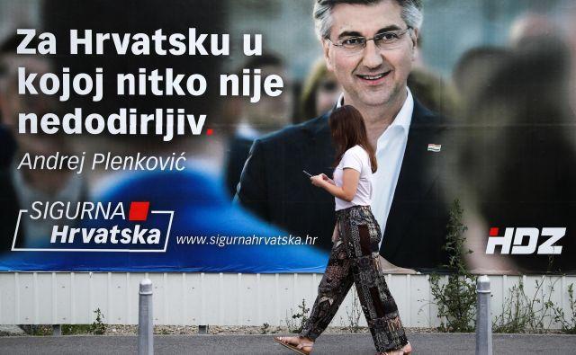 Zdajšnji hrvaški premier in šef desnosredinske HDZ Andrej Plenković računa na še en mandat. FOTO:Marko Djurica/Reuters