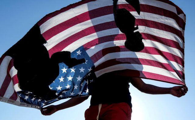 Američani so v ideološkem viharju. FOTO:Ringo Chiu/Reuters