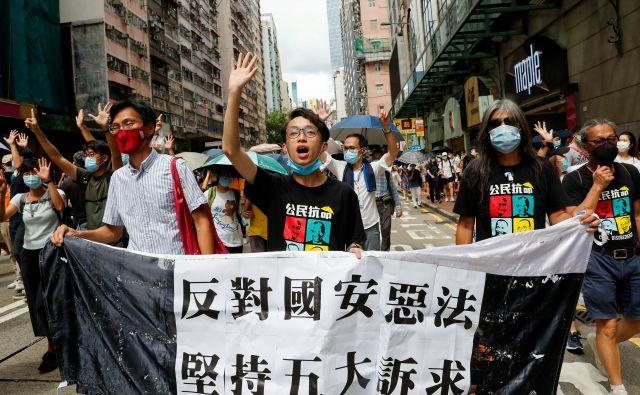 Hongkong me je vedno spominjal na dober cirkus, ker je v njem vladala disciplinirana hrabrost. FOTO: Tyrone Siu/Reuters