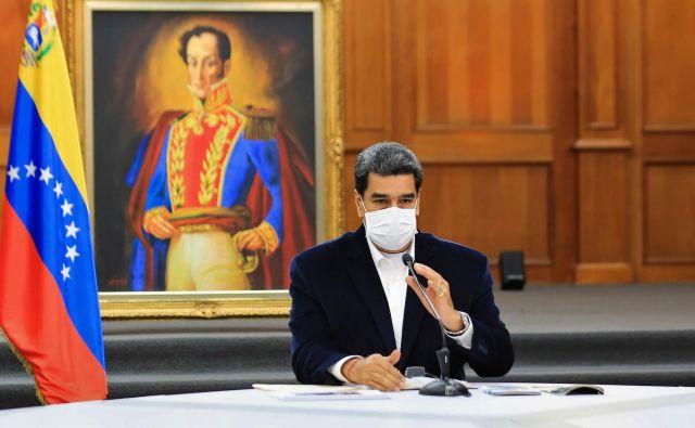 Vlada Nicolása Madura bo morala najti alternativno rešitev za svoje likvidnostne težave. Foto Jhonn Zerpa/Afp