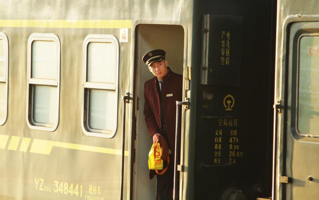 FOTO:Mož, ki je stal vse do Pekinga