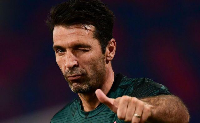 Legenda Gianluigi Buffon že ve, Juventus je devetič zapored osvojil naslov italijanskega prvaka. FOTO: Miguel Medina/AFP