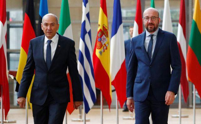 Janez Janša se je v Bruslju srečal tudi s predsednikom evropskega sveta Charlesom Michelom. FOTO: Francois/Lenoir Reuters