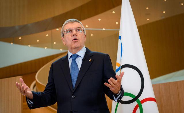 Prvi mož MOK Thomas Bach je nedavno obiskal francoskega predsednika Emmanuela Macrona. Pariz bo leta 2024 gostil olimpijske igre. FOTO: Fabrice Coffrini/AFP