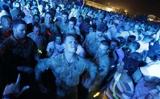 Ameriške medije so preplavile informacije o tako imenovanih koronapartijih, na katerih udeleženci menda tekmujejo, kdo se bo prej okužil. FOTO: Oleg Popov/Reuters