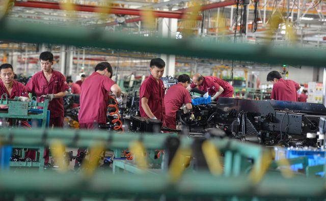 Za Peking je izjemno pomembno, da je Kitajska postala prvo veliko gospodarstvo, ki mu je uspelo povrniti rast še za časa pandemije. Foto Str/AFP