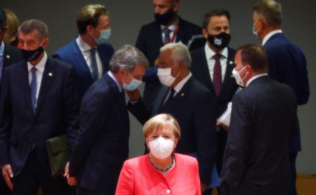 Angela Merkel, kanclerka gospodarsko najmočnejše članice EU, je ob začetku vrha prejemala čestitke za 66. rojstni dan.Foto: Francois Lenoir/Reuters