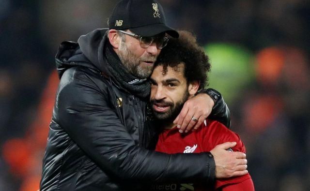 Jürgen Klopp in Mohamed Salah sta Liverpoolu prinesla tako dolgo pričakovano lovoriko. FOTO: Carl Recine/Reuters