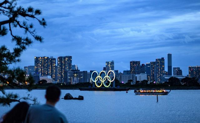 Če ne bi bilo pandemije, bi se ta petek veselili olimpijade v Tokiu. FOTO: Philip Fong/AFP