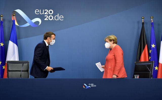 Angela Merkel in Emmanuel Macron FOTO: John Thys/Reuters