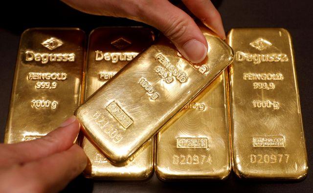 Žlatna kovina je v krizi najbolj zaželena naložba. FOTO: Edgar Su/ Reuters