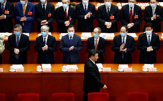 Xi do kritik znotraj partije ni niti toliko strpen, kot so bili njegovi predhodniki. FOTO: Thomas Peter/Reuters