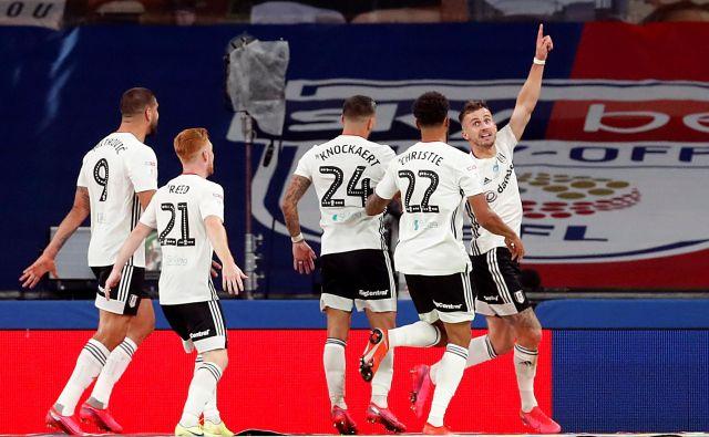 Joe Bryan (z dvignjeno roko) je bil junak Fulhamovega uspeha na Wembleyju. FOTO: Reuters