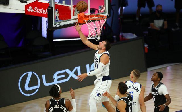 Luka Dončić niza vrhunske statistične dosežke kot za stavo. FOTO: Kim Klement/USA Today Sports