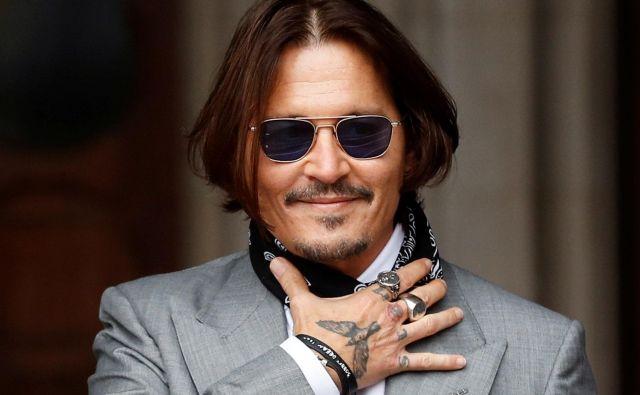 Johnny Depp med sojenjem v Londonu. FOTO: Peter Nicholls/Reuters