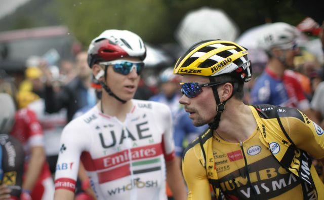 Primož Roglič (desno) je po zmagi na dirki Tour de l'Ain favorit pred kriterijem Dauphine, na katerem bo med njegovimi tekmeci tudi Tadej Pogačar. FOTO: Jure Eržen/Delo