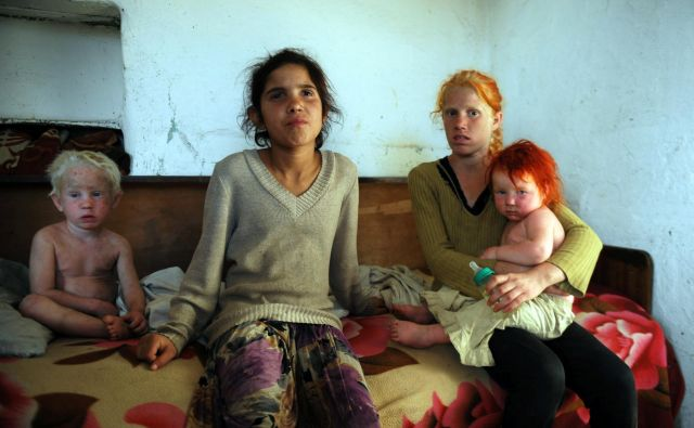 "A picture taken on October 24, 2013, shows four of the children of Sasha Ruseva and Atanas Rusev in the Roma district of the central Bulgarian town of Nikolaevo. Bulgarian authorities today questioned a couple thought to be the parents of Maria, a mysterious blonde girl whose discovery in a Greek Roma camp made global headlines. The woman, Sasha Ruseva, was quoted as saying outside the police station in the central town of Gurkovo that desperate poverty had forced her to leave behind a baby in Greece and that Maria looked like she might be hers. ""There is a resemblance, but how should I know if she is mine or not?,"" the thin, dark-complexioned Ruseva told reporters, clutching a small, freckled and pale-skinned child of two or three with dyed red hair. AFP PHOTO / NIKOLAY DOYCHINOV Foto Nikolay Doychinov Afp - International News Agency"