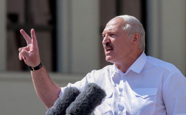 Beloruski predsednik Aleksander Lukašenko se je pohvalil pred podporniki, da je v državi naredil red. FOTO: Siarhei Leskiec/AFP