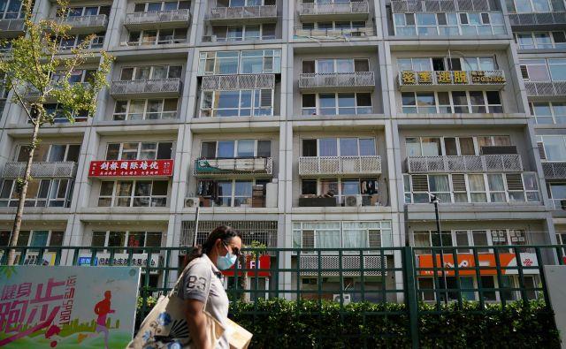 V sektorju nepremičnin ponekod že razmišljajo o ukrepih za ohladitev trga, saj so cene stanovanj precej zrasle. FOTO: Tingshu Wang/Reuters