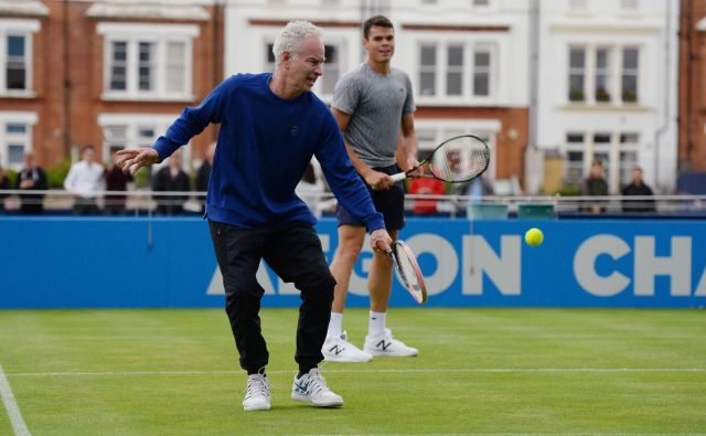 Britain Tennis - Aegon Championships - Queens Club, London - 13/6/16<br /> John McEnroe and Canada&#39;s Milos Raonic during a practice session<br /> Action Images via Reuters / Tony O&#39;Brien<br /> Livepic<br /> EDITORIAL USE ONLY. - RTX2G02Z Foto Š Tony O&#39;brien / Reuters Reuters