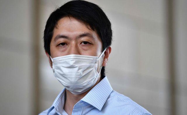 Ted Hui se je pod ključem znašel zaradi domnevnega poskusa oviranja pravosodja in dostopa do računalnika s kriminalnimi nameni. FOTO: AFP