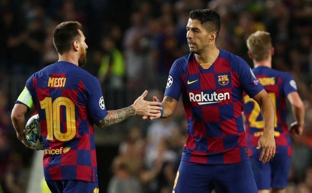 Luis Suarez (desno) je v Barceloni odlično sodeloval z Lionelom Messijem. FOTO: Sergio Perez/Reuters