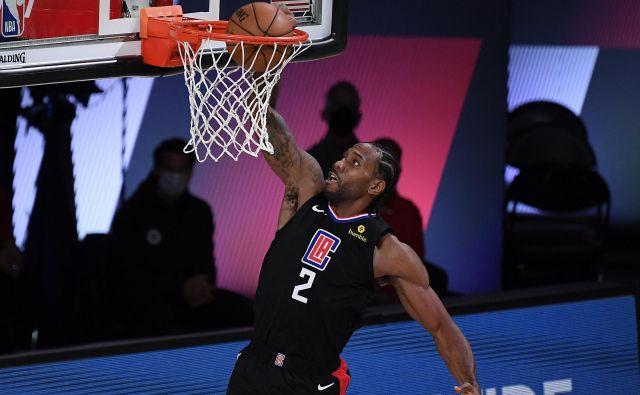 Kawhi Leonard je znova prispeval levji delež k zmagi moštva Los Angeles Clippers. FOTO: Douglas P. Defelice/AFP