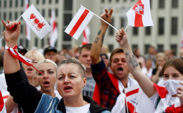 Protesta v Minsku se je udeležilo 60.000 ljudi. FOTO: Vasily Fedosenko/Reuters
