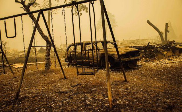 Vsaj 14 ljudi je umrlo, zrak pa je najbolj onesnažen na svetu. FOTO: Kathryn Elsesser/AFP