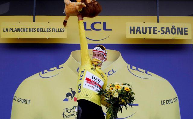 Veliki zmagovalec dirke po Franciji bo jutri dopolnil 22. let. FOTO: Sebastien Nogier/AFP