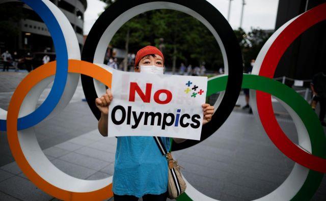 Na Japonskem so še vedno glasni tudi nasprotniki olimpijskih iger 2021 v Tokiu. FOTO: Issei Kato/Reuters