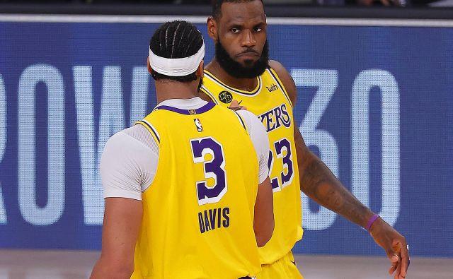 LeBron James in Anthony Davis sta bila zadovoljna z razpletom četrte tekme. FOTO: Mike Ehrmann/AFP