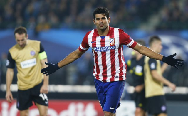 SOCCER-CHAMPIONS/ Atletico Madrid's Costa celebrates scoring goal against Austria Vienna during Champions League match in Vienna