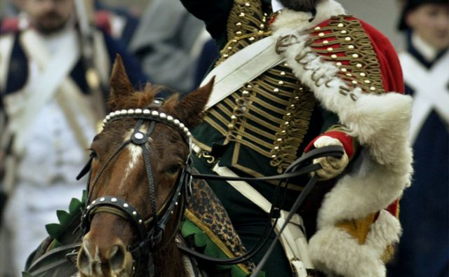 reut*RUSSIAN COSSACK RIDES HIS HORSE DURING THE