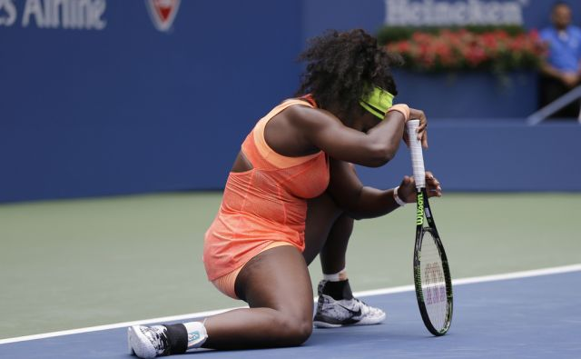 Serena Williams reacts after losing a point Roberta Vinci, of Italy, during a semifinal match at the U.S. Open tennis tournament, Friday, Sept. 11, 2015, in New York. (AP Photo/David Goldman)