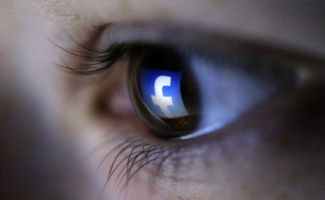 FACEBOOK-DATA/ A picture illustration shows a Facebook logo reflected in a person's eye, in Zenica
