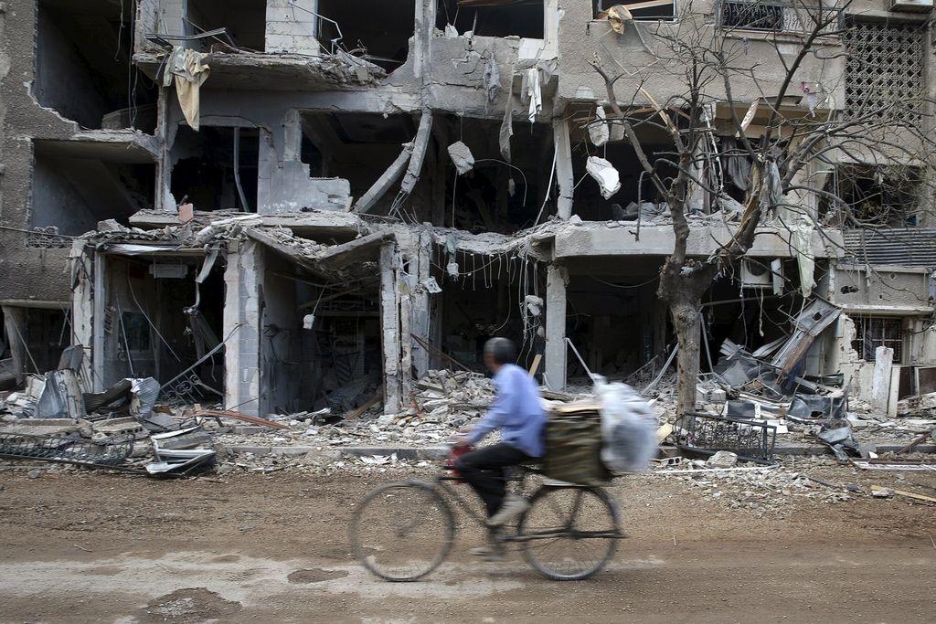V eksplozijah v Damasku in Homsu ubitih najmanj 119 ljudi