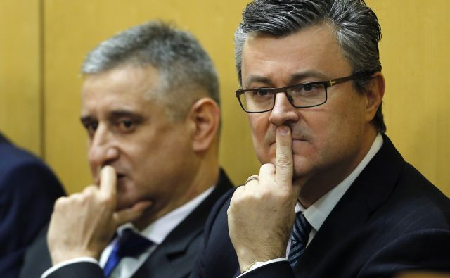 Croatia's Prime Minister-designate Tihomir Oreskovic (R) and new First Deputy Prime Minister Tomislav Karamarko seek approval for the new government in parliament in Zagreb, Croatia, January 22, 2016. REUTERS/Antonio Bronic