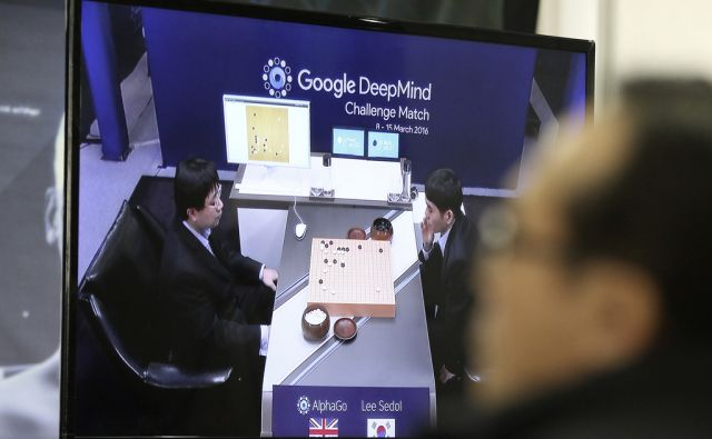 A man watches a TV screen showing the live broadcast of the Google DeepMind Challenge Match at Korea Baduk Association office in Seoul, South Korea, Wednesday, March 9, 2016. Computers eventually will defeat human players of Go, but the beauty of the