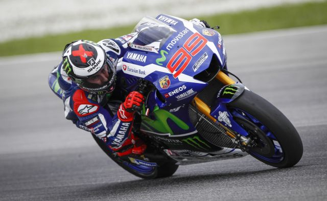 MotoGP rider Jorge Lorenzo of Spain steers his Yamaha out of a corner during a pre-season test at Sepang International Circuit in Sepang, Malaysia, Wednesday, Feb. 3,  2016. (AP Photo/Joshua Paul)