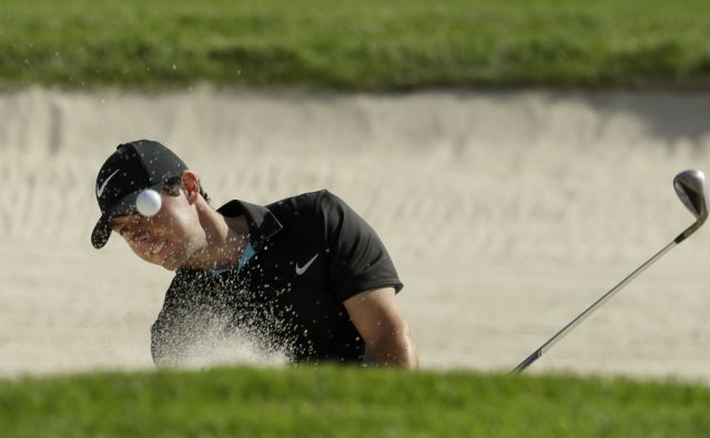 Rory McIlroy, of Northern Ireland, hits out of the bunker on the 13th hole during a practice round for the U.S. Open golf championship at Oakmont Country Club on Tuesday, June 14, 2016, in Oakmont, Pa. (AP Photo/Charlie Riedel)