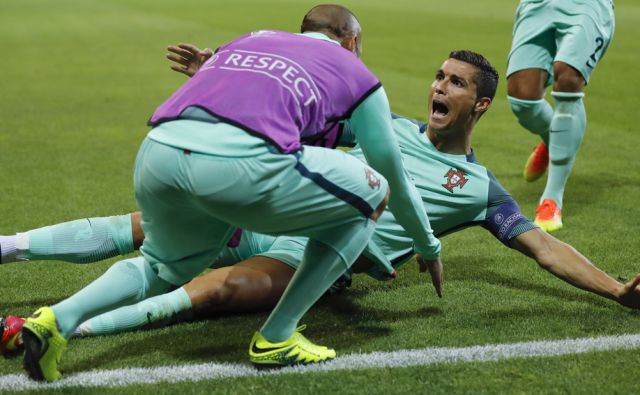 Portugal's Cristiano Ronaldo celebrates after scoring his side's first goal during the Euro 2016 semifinal soccer match between Portugal and Wales, at the Grand Stade in Decines-Charpieu, near Lyon, France, Wednesday, July 6, 2016. (AP Photo/Frank